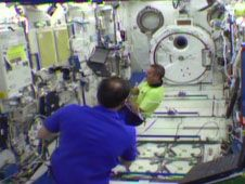 Commander Chris Hadfield (background)<br /> and Flight Engineer Tom Marshburn work<br /> in the Kibo module of the International<br /> Space Station.<br /> Credit: NASA TV